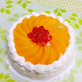 黄桃の缶詰でケーキのデコレーション